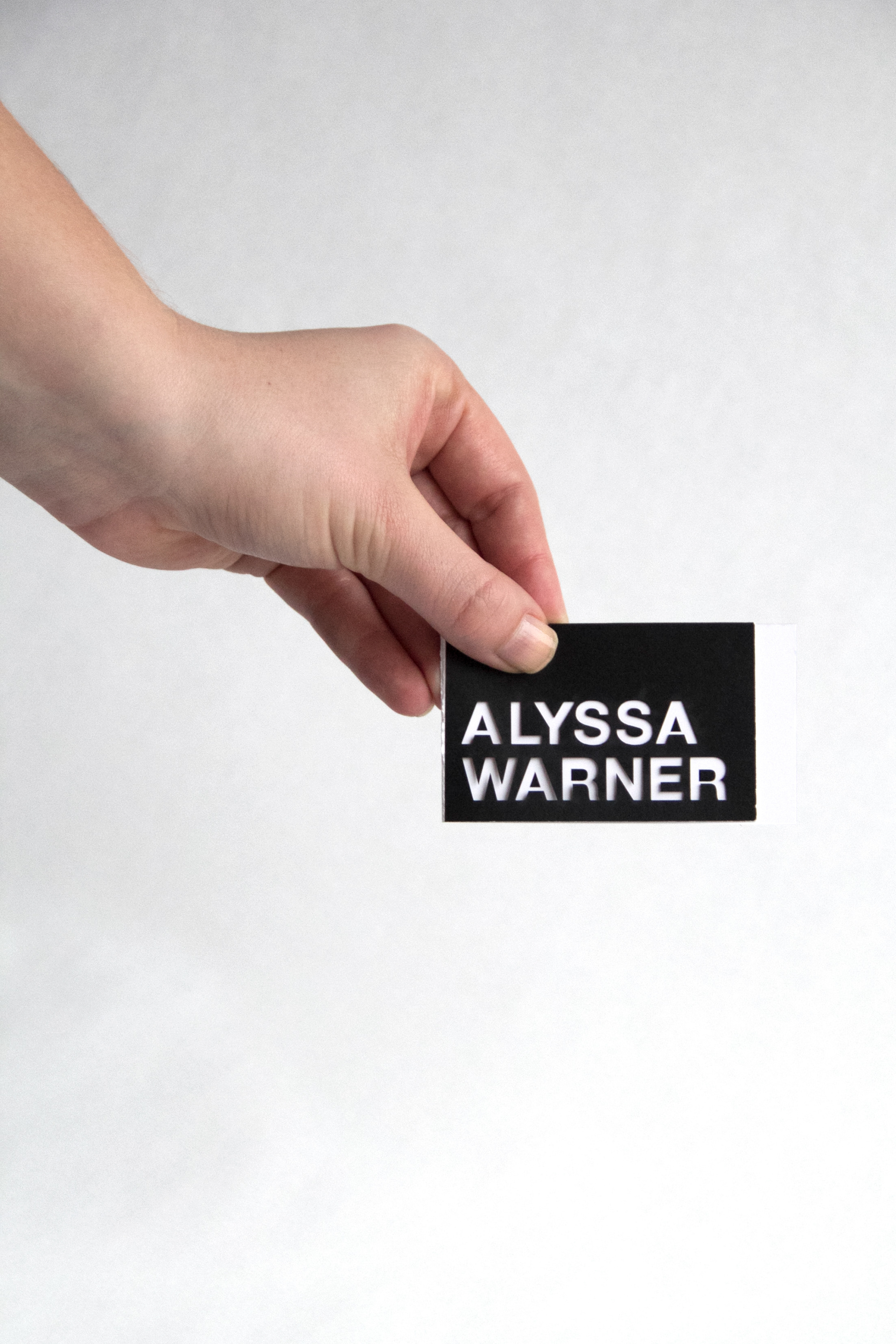 Alyssa warner brand and identity my business card focuses on the negative space in my name and the fun shapes that are formed from them i used a laser cutter to get the perfect cut colourmoves