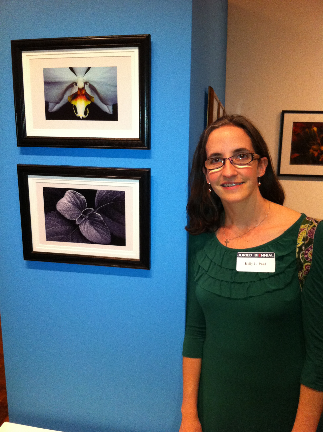 Kelly Paal at Westmoreland Museum of American Art with 2 of her photos.