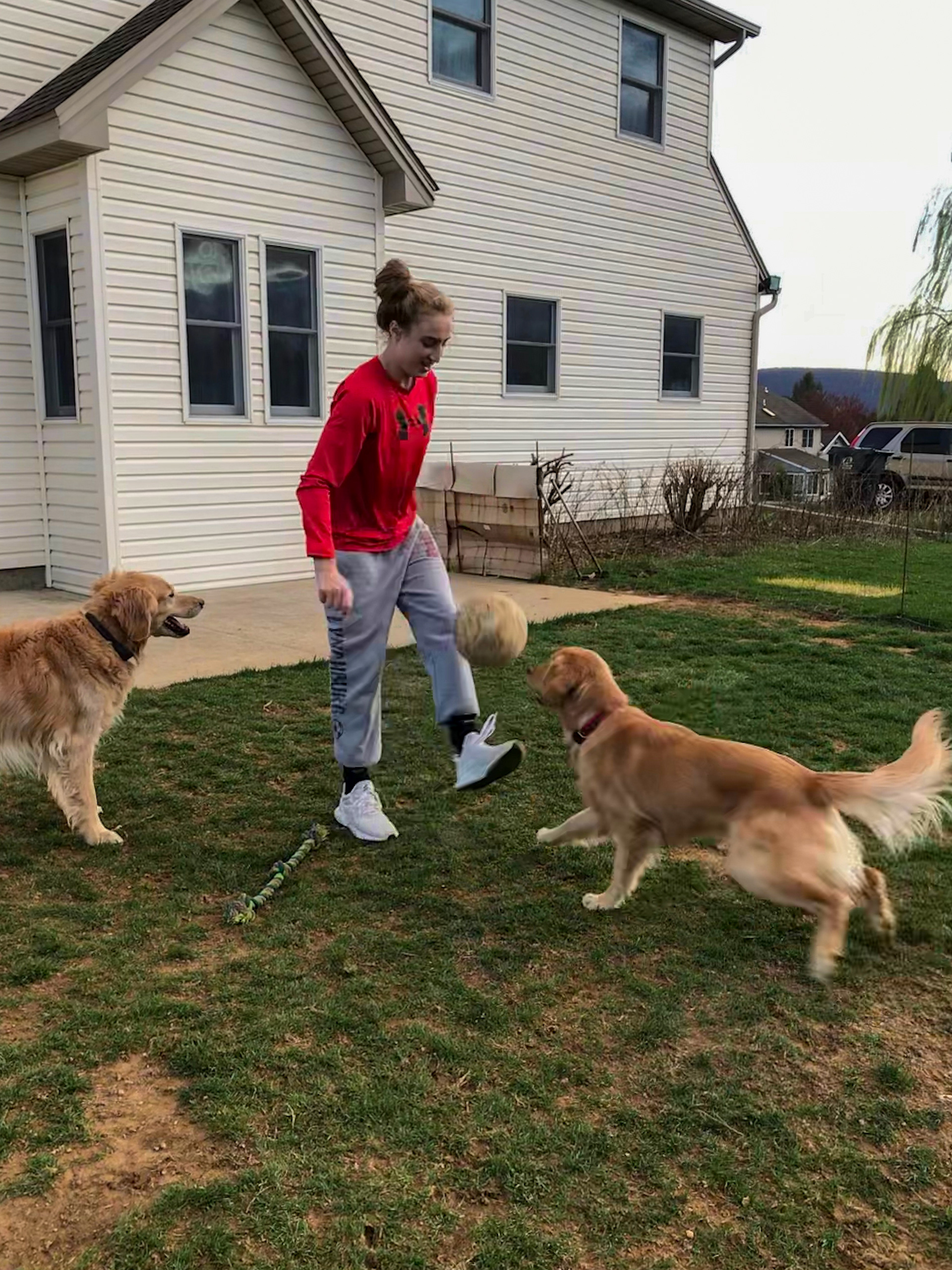 Sarah Pavlovich juggling a soccer ball in her backyard with her dogs, March 30th, 2020. Sarah Pavlovich  |  Carlisle, Pennsylvania.